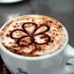 Image of a coffee with a chocolate flower on top