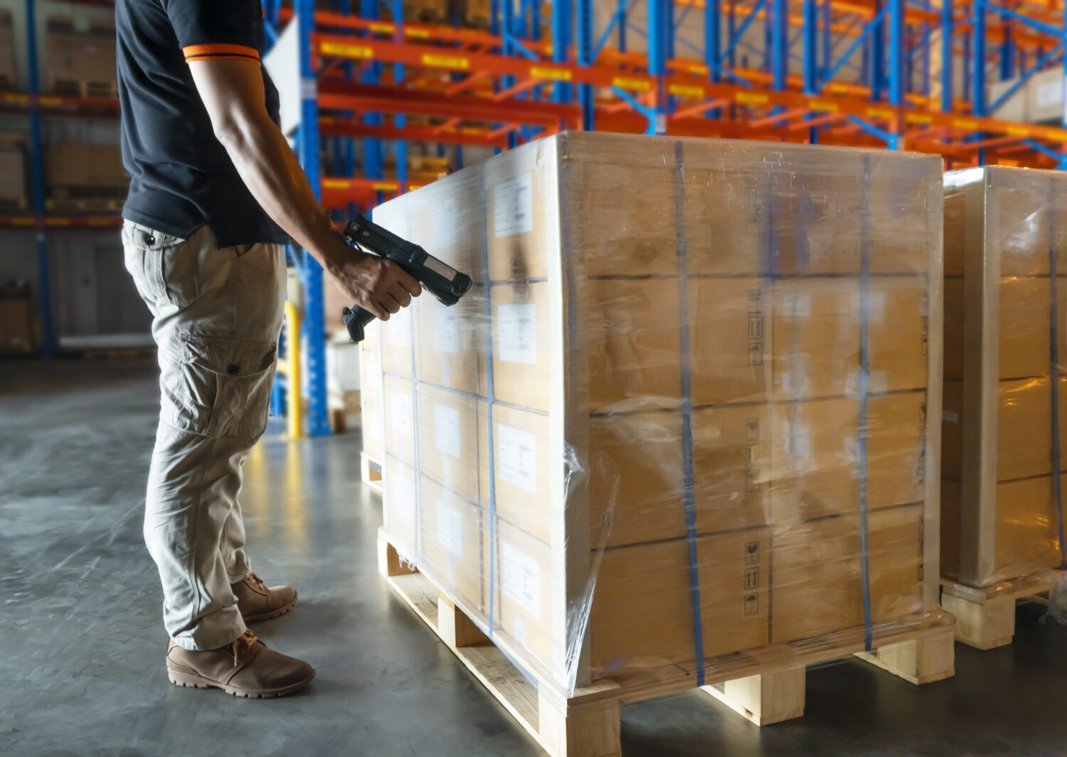 warehouse worker using barcode inventory systems