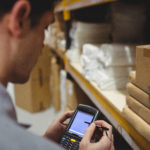 Compliant barcoding solutions: warehouse worker using barcode scanner