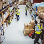 Compliant barcoding solutions: Warehouse worker using hand scanner in warehouse