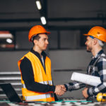 warehouse workers shaking hands