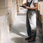Warehouse worker taking stock