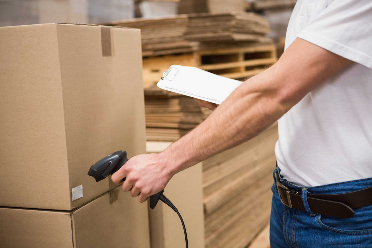 warehouse worker using barcoding inventory systems