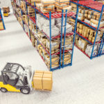 stock control software. forklift in warehouse.