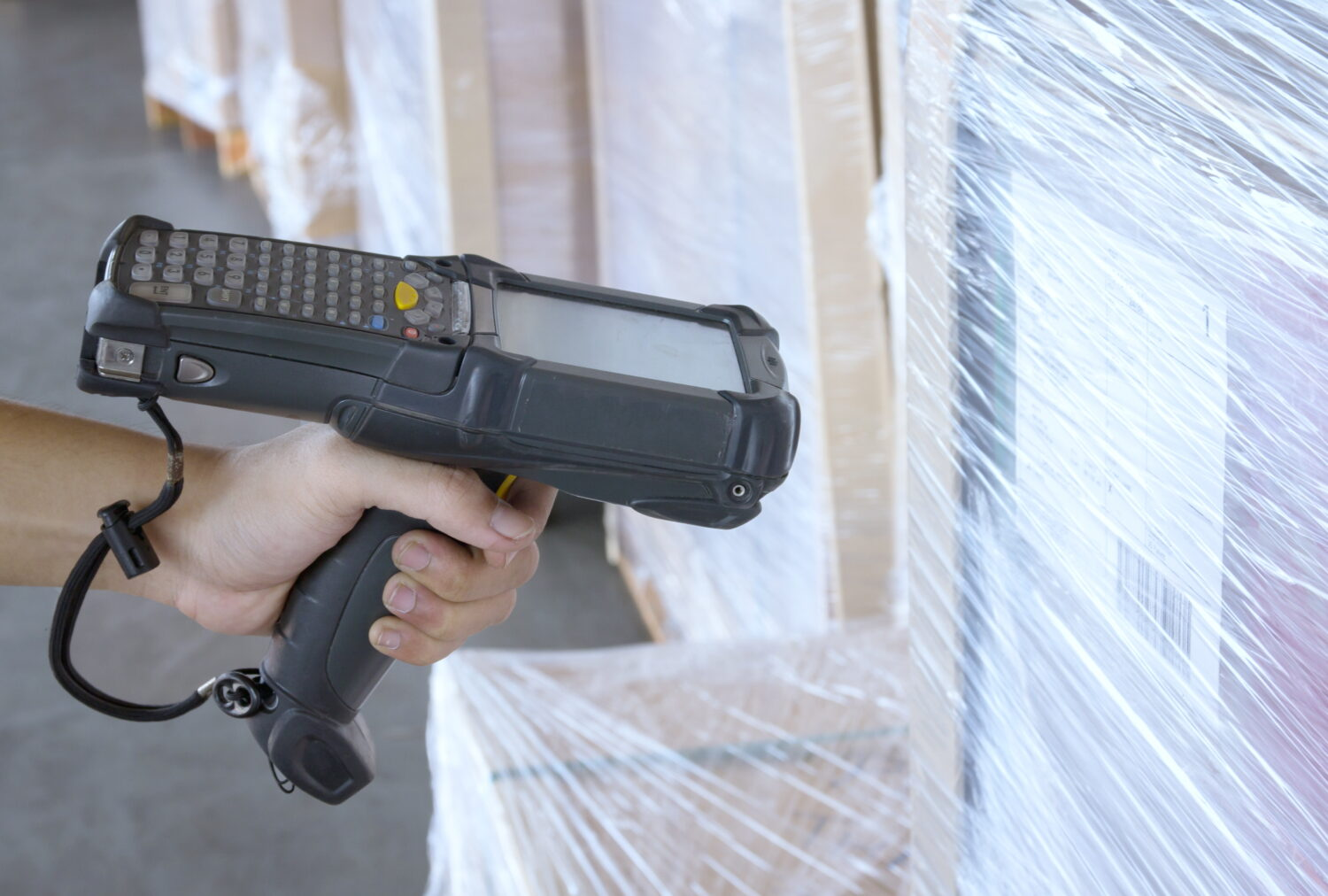 handheld scanner in a warehouse