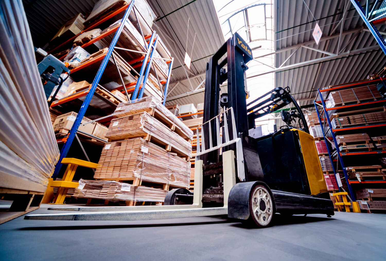 Forklift loader in storage warehouse ship yard. Distribution products. Delivery. Logistics. Transportation. Business background